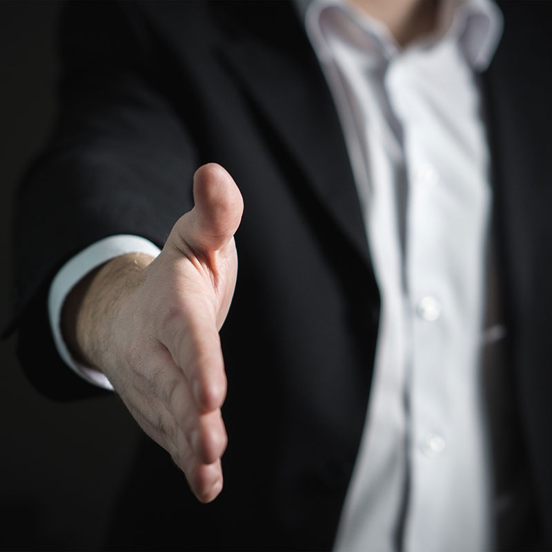 Man extending hand for a handshake