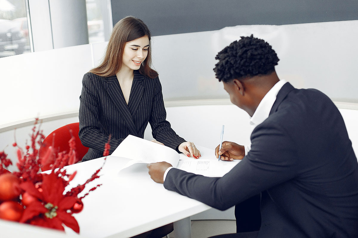 Business man and woman signing papers